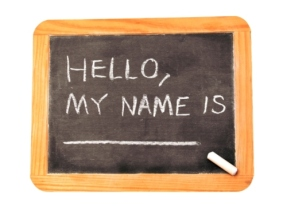 "Isolated chaulkboard that states ""hello, my name is"""